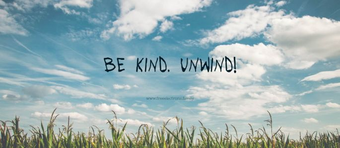 Be kind. Unwind. www.freeelectrons.family. Scattered clouds. Baby blue sky. uncut grass in the foreground. Big Smile!