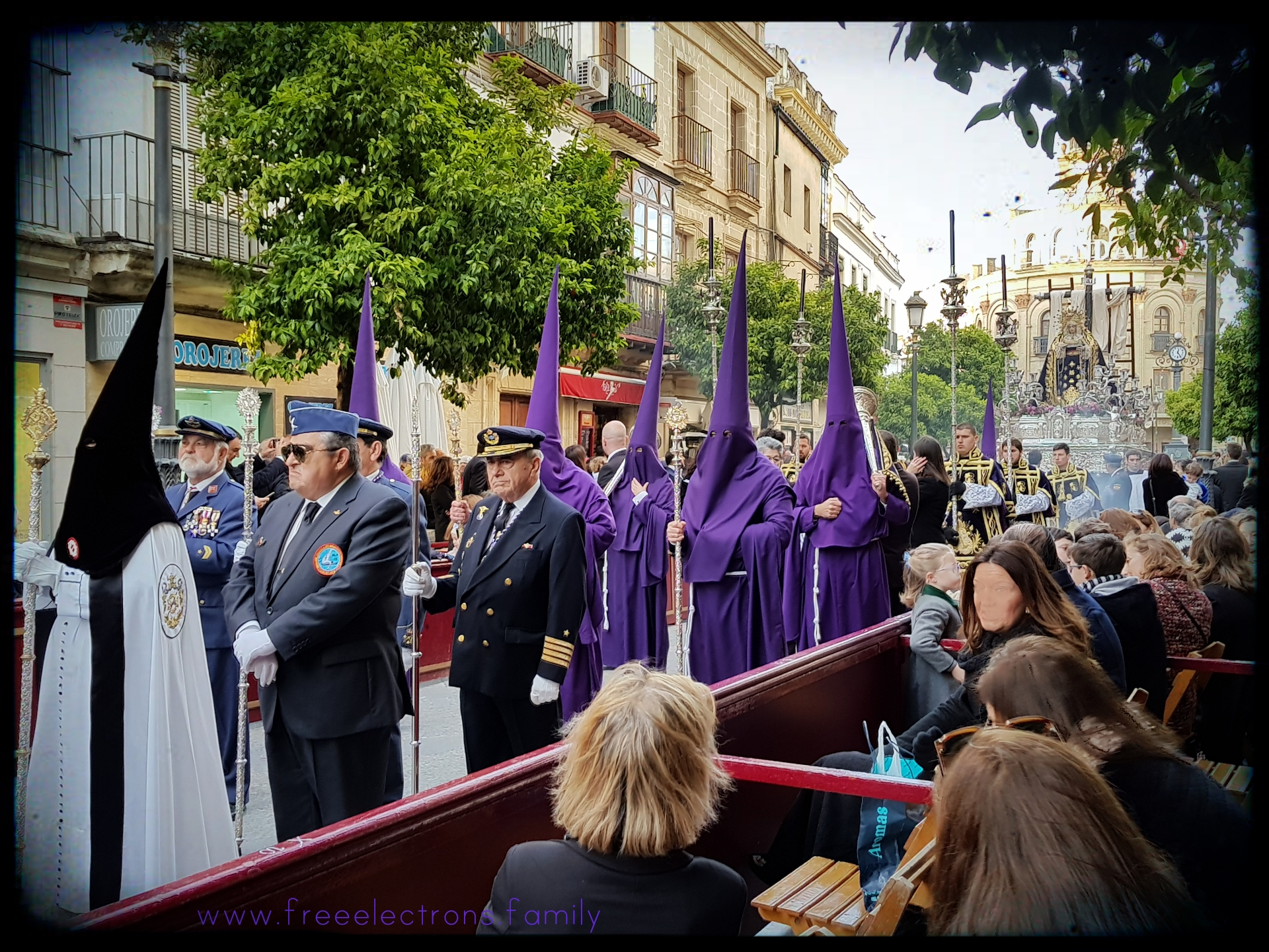 Easter in Jerez de la Frontera, Andalucia, Spain. Hooded penitents marching down calle Larga.