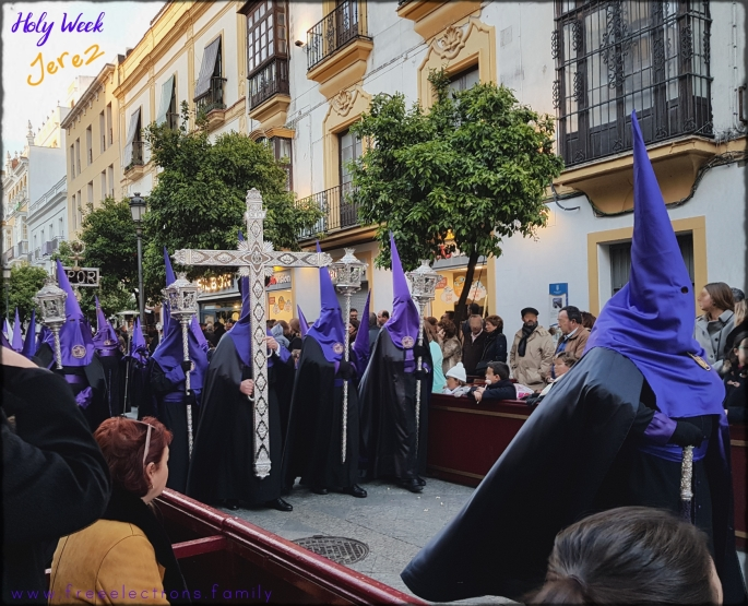 A procession of piety during Holy Week (Semana Santa) along Calle Larga, Jerez de la Frontera, Spain.