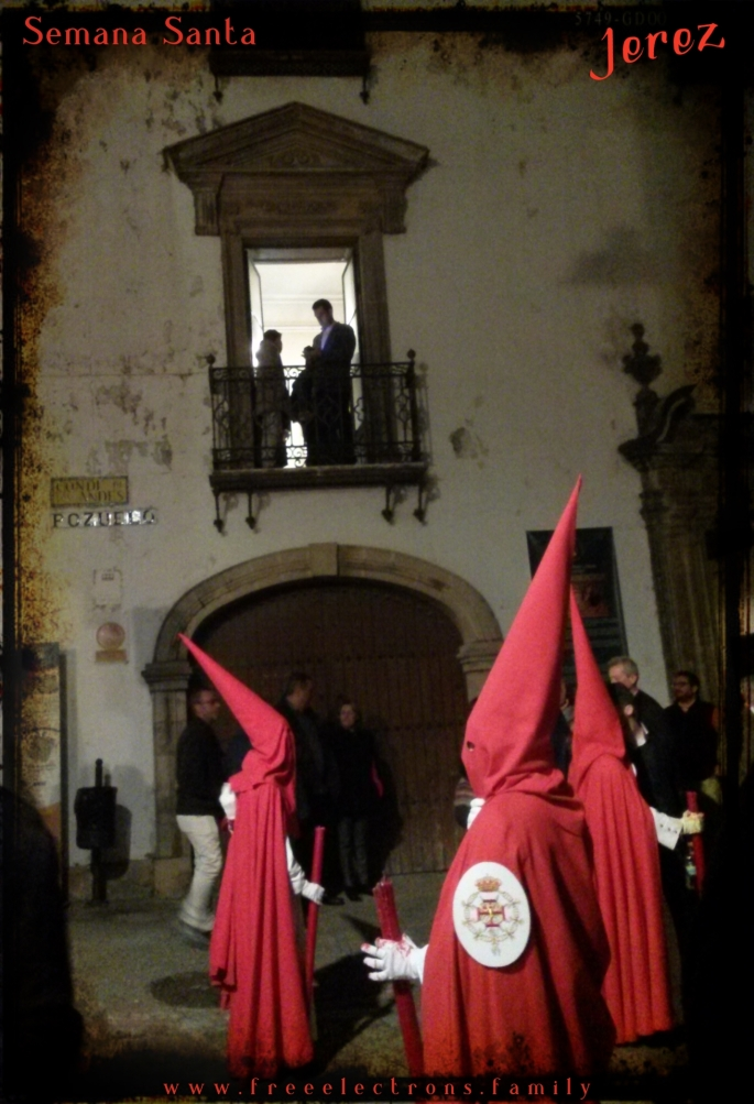 "A procession during Holy Week (Semana Santa) along Calle Pozuelo, Jerez de la Frontera, Spain. Penitents await the chanting of Saeta--a unique form of religious song about ""the suffering, death, and majesty of Jesus Christ, and of the grief of the Virgin Mary""-D.E. Pohren. This is one of the primitive songs that made its way into Flamenco."