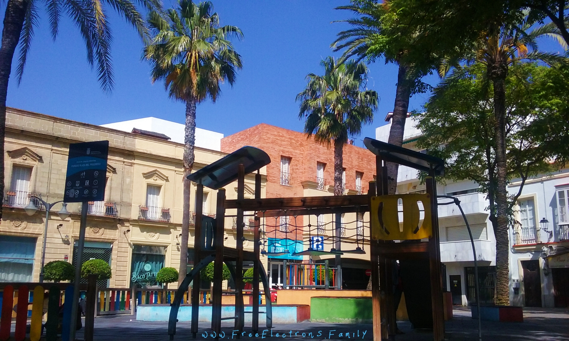 Plaza del Progresso:  old and worn-out play things at the plazas Area de Juegos Infantiles (playground) surrounded by tapas bars/restaurants.