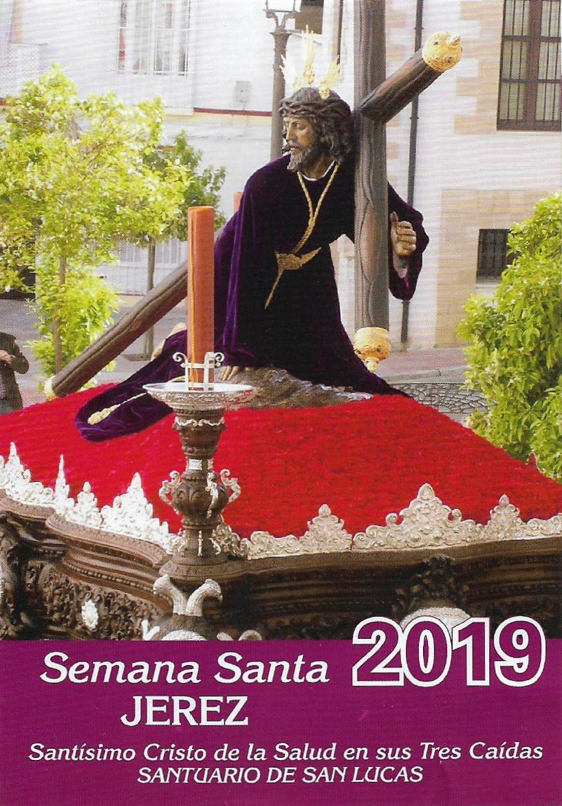 Picture of Jesus on a adorned red platform float, wearing a purple robe with golden highlights, kneeling and carrying a cross. Semana Santa 2019 in Jerez de la Frontera.