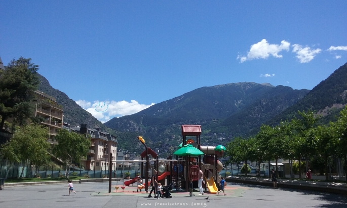 #FreeElectrons.Family - camping road trip Europe, Andorra town square.  The other playground on Plaça del Poble (town square) in Andorra-la-Vella where kids can play in relatively safety of the enclosed playground.  Keep an eye out though!
