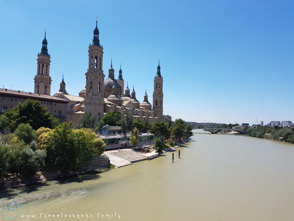 A view of the Catedral-Basílica de Nuestra Señora del Pilar (Cathedral-Basilica of Our Lady of the Pillar) from the Puente de Piedra (Stone Bridge) over the Ebro river. Third stop on our #FreeElectrons.Family summer camping road trip Europe, Day 5 in Zaragoza.