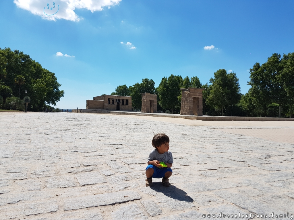 #FreeElectrons.Family - camping road trip Europe, Madrid. A young boy sitting, chillin' at the Temple of Debod--a 2,000 year old stone structure brought stone-by-stone from Egypt.