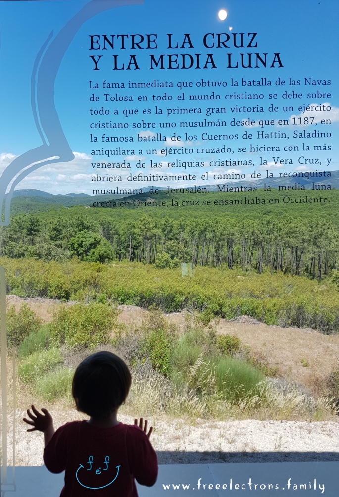 "A young child stares outward from the bay window of the museum towards the mountain site of the decisive battle ""Between the Cross and the Half Moon"" in 1212. A #FreeElectrons.Family camping road trip Europe I stop in Santa Elena, Jaen, Spain."