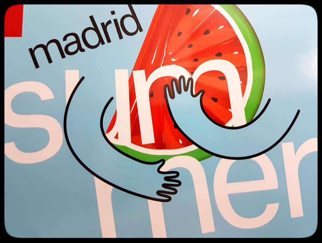 "Madrid summer logo, arms hugging a watermelon to show:""Madrid Te Abraza!"" from esMadrid.com magazine"
