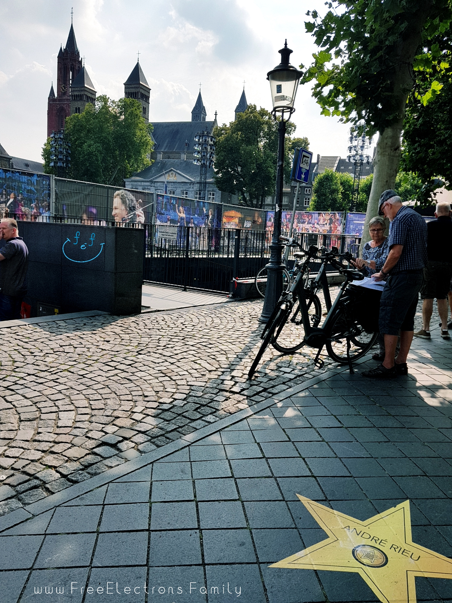 Maastricht, the city of Andre Rieu.  Pictures of the composer in the background in preparation for a concert.  A star on the street with the musicians name imprinted on it.  #FreeElectrons.Family - camping road trip Europe Maastricht