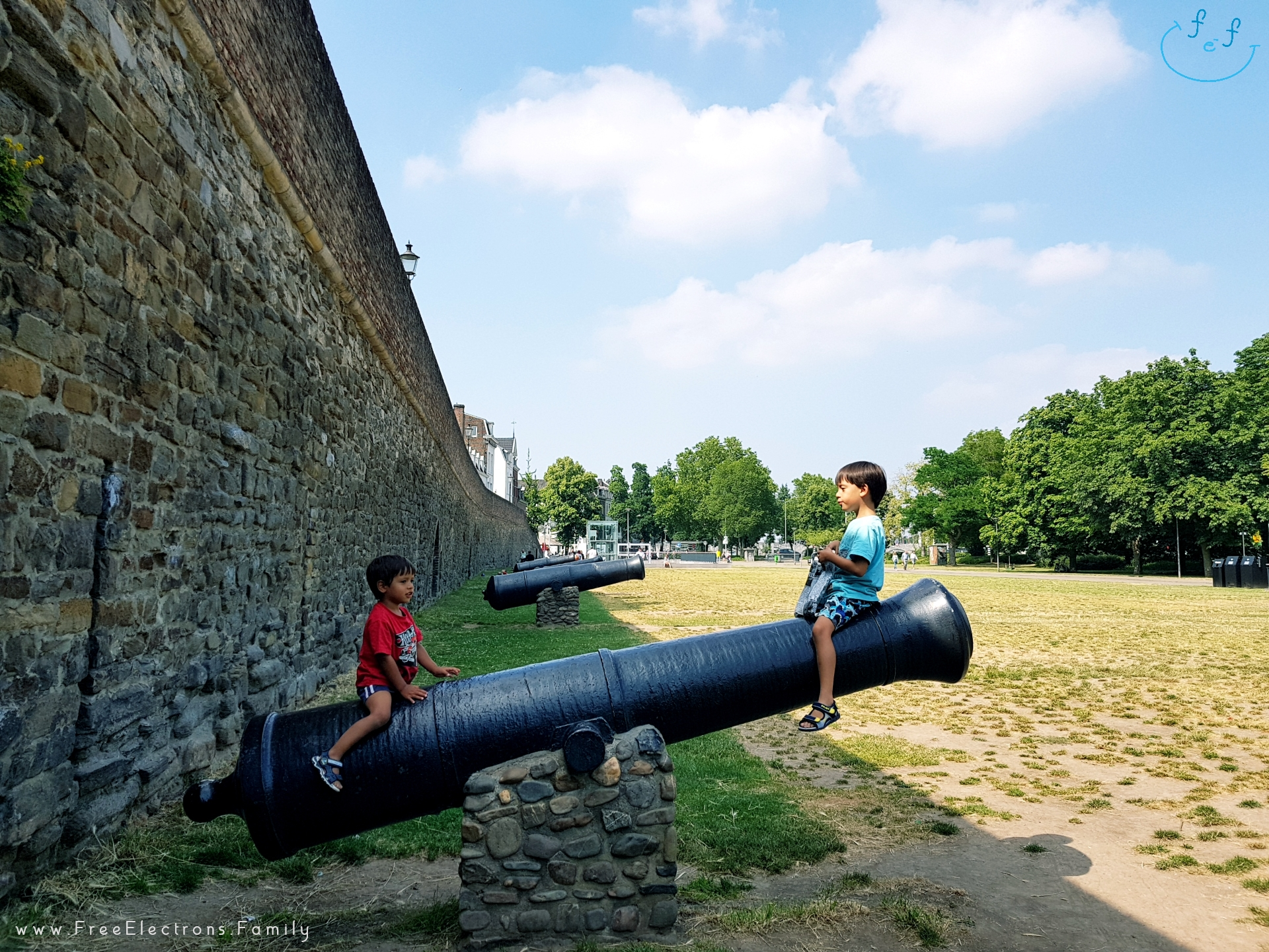 Canons surrounding the defensive walls around the old city of Maastricht within the gate of hell (Helport).    Two young kids playfully riding on one.  #FreeElectrons.Family - camping road trip Europe Maastricht