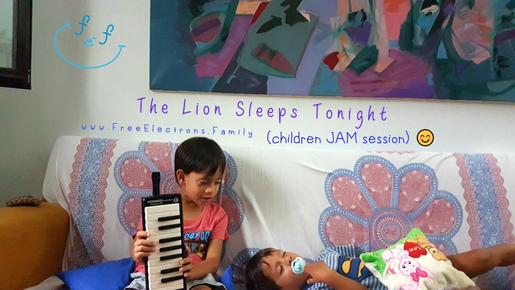 "Two children on a sofa.  One is holding a melodica (music) instrument while looking at his little brother who is sleeping on the couch.  Text on picture reads: The Lion Sleeps Tonight, children jam session.  Caption Reads:  An open ""jam session"" for children: a family-fun activity!  Ok, ok!... the little one passed out right after the music session.  Yay!  www.FreeElectrons.Family."