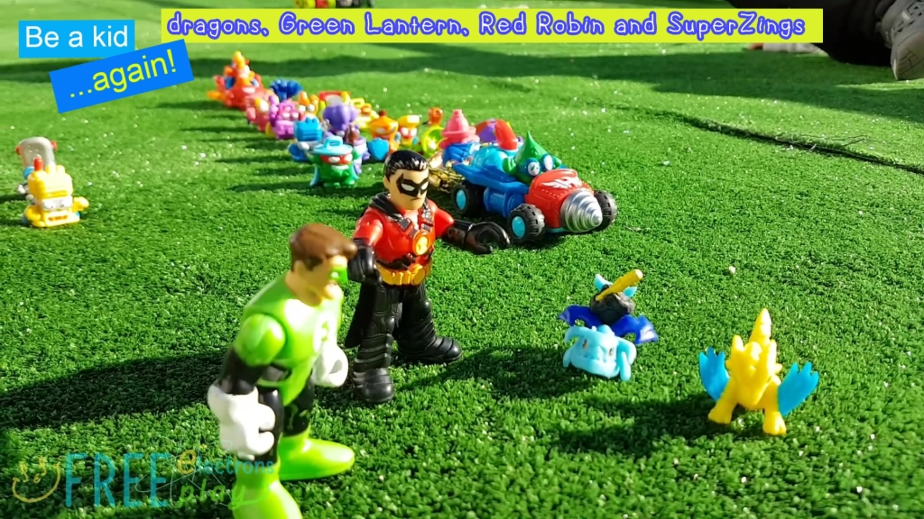 "SuperZings with Imaginext and little dragons.  Text reads, ""Be a kid. . . again!.""-Free Electrons Family"