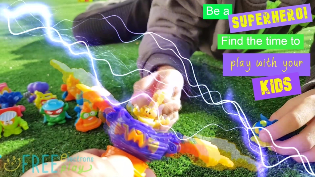 "SuperZings toys with special lightning/electric effects.  Text reads, ""Be a Superhero! Find the time to play with your kids.""-Free Electrons Family"