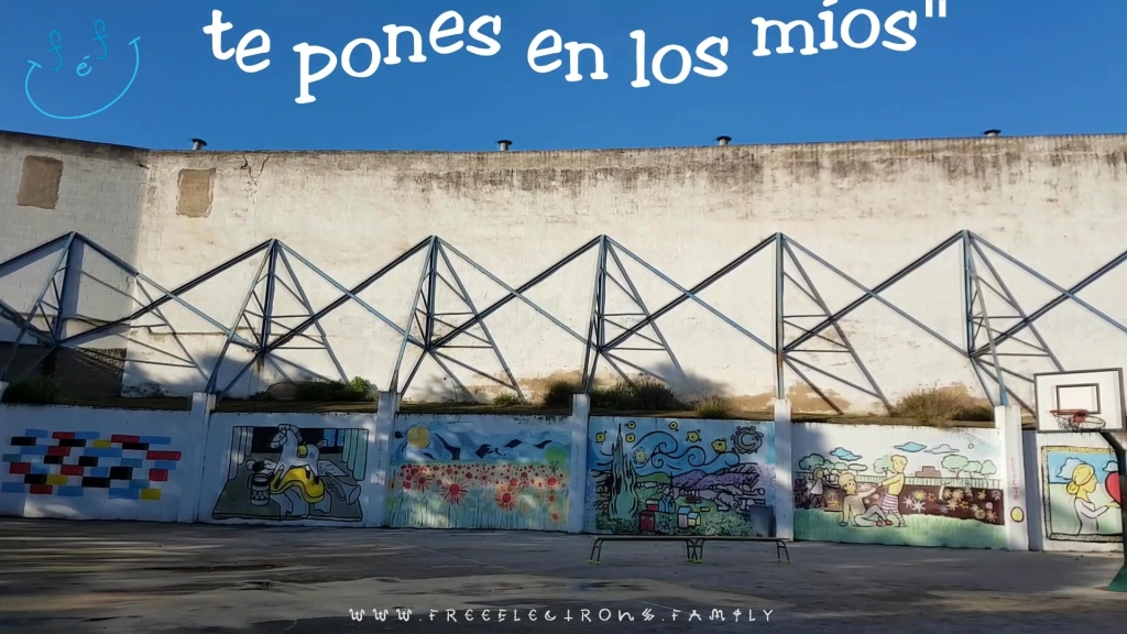 """An outdoor patio with various paintings on the walls.  Text reads in Spanish, """"te pones en los mios"""" you put yourself in mine).   www.FreeElectrons.Family"""