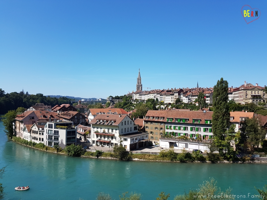 A picturesque view of the old city of Bern with the turquoise Aare river in the foreground and the cathedral in the background. www.FreeElectrons.Family