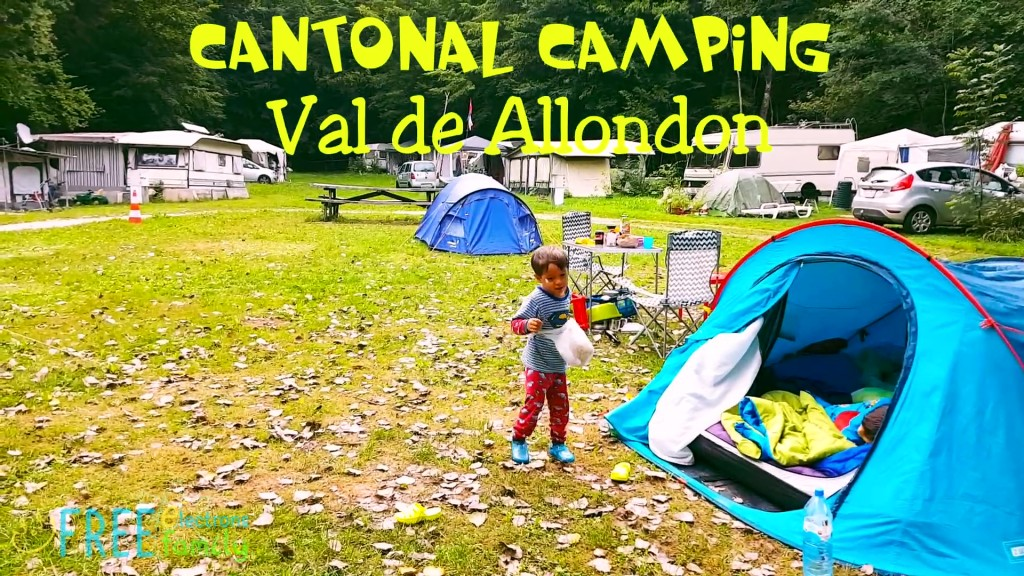 A young kid playing outside a tent in a idyllic-looking campsite.   Text reads: Cantonal Camping Val de Allondon.  www.FreeElectrons.Family