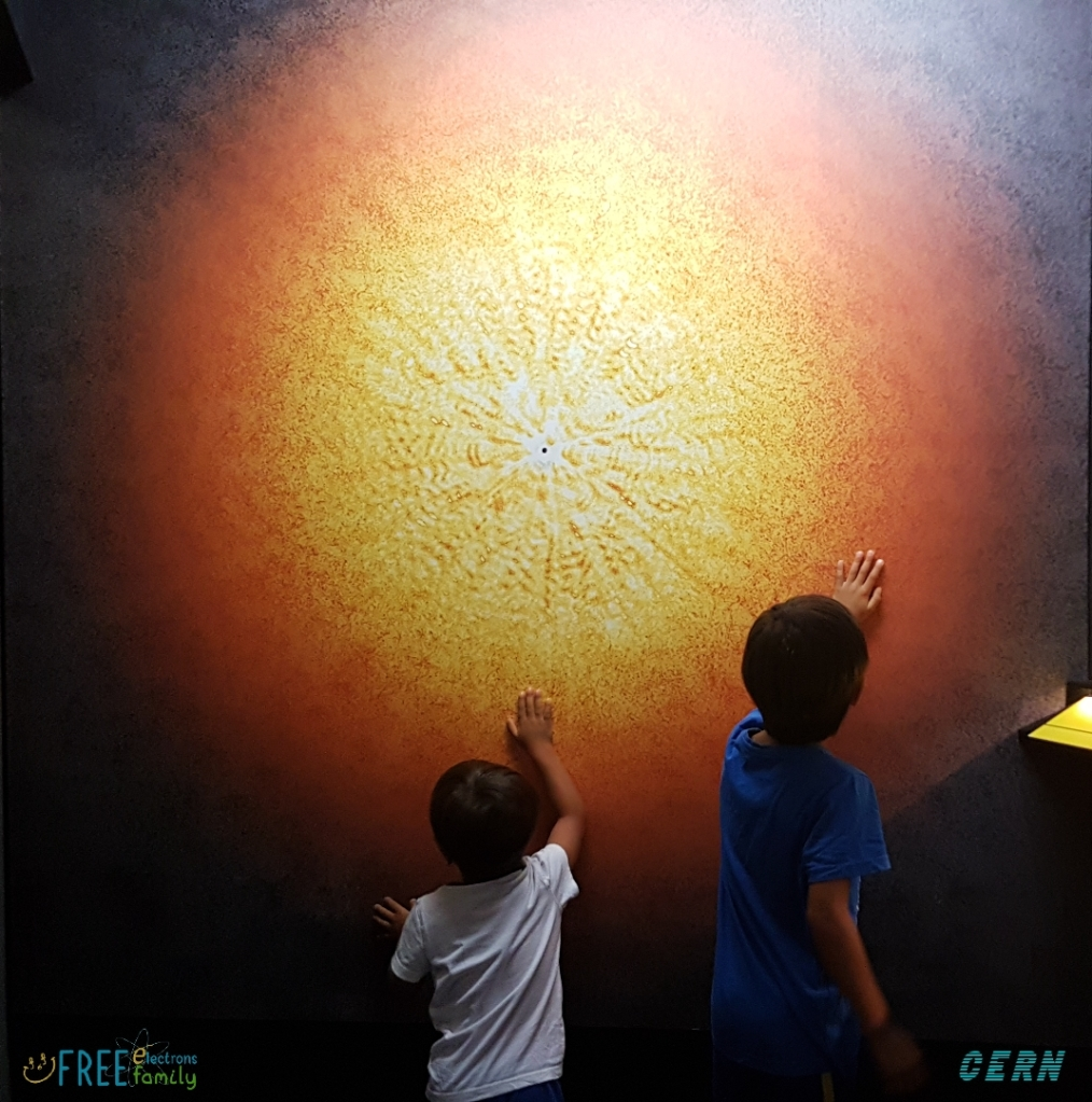 Two young children touching a wall of the BIG BANG!   #FreeElectrons.Family