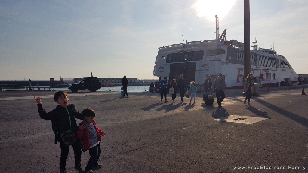 Happy young boys and other passengers after disembarking from a ferry.
